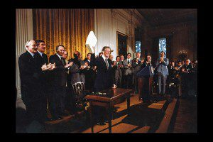 President Jimmy Carter celebrates after signing the Alaska National Interest Conservation Act on December 2, 1980. Jimmy Carter Presidential Library photo.