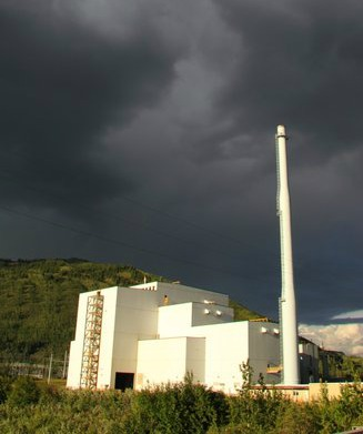 "Stormy clouds over the Healy ""Clean Coal"" Plant seem to be predicting its future. Photo courtesy of Bretwood Higman, Erin McKittrick, Ground Truth Trekking"
