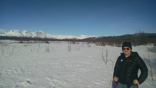 Kendall enjoyed many outings to experience Alaska. Here she is shoeshoeing in Denali State Park with the Denali Range in the background. Photo courtesy of Kendall Hamilton.