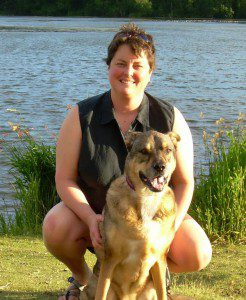 Vicki Clark and her dog Tamarack that came North with her to work at Trustees.