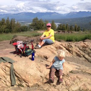 Judy Donegan, on the Board of the Castle Mountain Coalition, with her grandson on the Butte in the Matanuska Valley