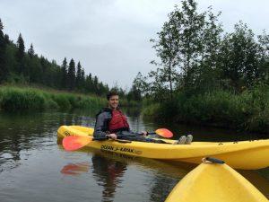 Intern Esack Grueskin kayaking on Byers Lake in Denali State Park.