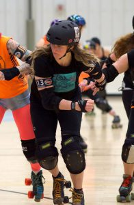 Playing roller derby