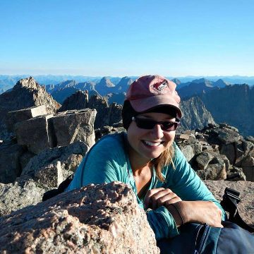 Kat sitting on top of Windom Peak, a fourteener in southwestern Colorado.