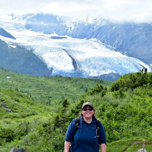 Photo of Catherine Danley in front of Portage Pass glacier. Catherine interned for Trustees this summer.