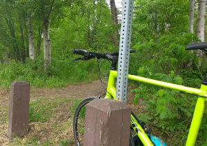 Kat bikes and then hikes from greenbelt to mountain top. Here's her bike at the trail head.