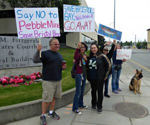 Emily stands between her dad Michael Gallegos and her aunt Mary Charles while protesting the Pebble mine.