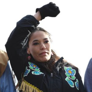 Bernadette Demientieff lifts an arm as a call to unity.